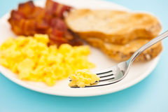 American breakfast, bacon and scrambled egg blurry Stock Photography