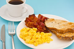 American breakfast, bacon scrambled egg and coffee. American breakfast, bacon and scrambled egg, with a cup of coffee Royalty Free Stock Images