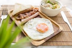 American breakfast beautiful fried egg on wood dish Stock Photography