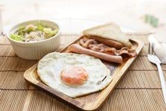 American breakfast beautiful fried egg on wood dish Royalty Free Stock Photos