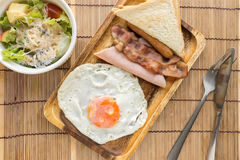 American breakfast beautiful fried egg on wood dish Stock Photos