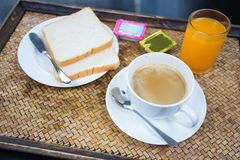 American Breakfast. Breads with butter,jam, coffee and orange juice in the morning Royalty Free Stock Images