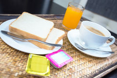 American Breakfast. Breads with butter,jam, coffee and orange juice in the morning Stock Photos