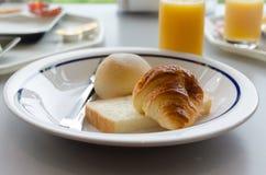 American breakfast closeup :croissant bun and a pi Stock Image