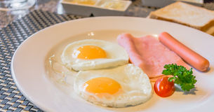 american Breakfast cooked and looks delicious in restaurant Stock Images