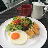 American Breakfast Egg, sausages and salad. In the cafe Stock Photos