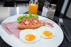 American breakfast with eggs ham bacon and sausage. It easy to eat and simple of food in morning.Everybody can eat easy and easy to cooking Royalty Free Stock Image