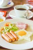 American breakfast fried egg with ham and sausages Royalty Free Stock Image