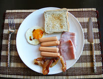 American breakfast has ham egg sausage beacon on tablemat Stock Photography