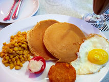 American breakfast with pancakes, eggs, corn and hash brown Royalty Free Stock Images
