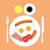 American breakfast top view. Eggs, sausage and bacon on a plate Royalty Free Stock Photo