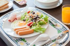 American breakfast on wood table.American breakfast with egg, sausage, bread and vegetable, royalty free stock photos
