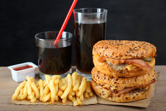 American burger, french fries. And a glass of soda on a black background Stock Photo