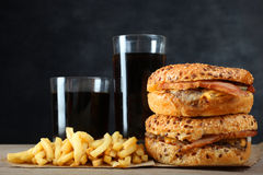 American burger, french fries. And a glass of soda on a black background Royalty Free Stock Images