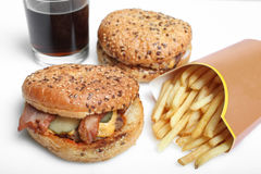 American burger, french fries and a glass of soda. Isolated on white background Royalty Free Stock Images