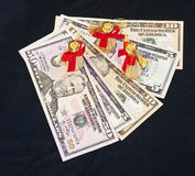 American Business Angels. Angels with ribbons and wings on top of United States Dollar bills representing business angels funding new businesses Stock Photos