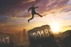 American businessman jumping above number 2018 Royalty Free Stock Photography