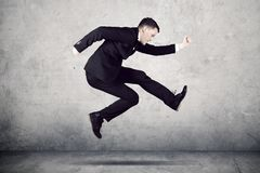 American businessman running with fast motion Stock Images