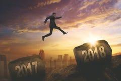 American businessman jumping toward number 2018 Stock Photos