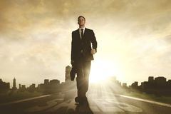 American businessman walking with sales word Stock Photos