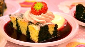 American cake. With strawberries and chocolate Stock Images