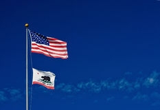 American and Californian flags in wind Royalty Free Stock Images