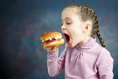 American calories fat meal Junk food, Little Girl enjoy eating hamburgers fast food burger unhealthy stock photos