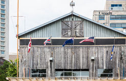 American and Canadian Flags on Old Wood Building Royalty Free Stock Photography