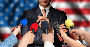 American candidate speaks to reporters - journalism concept Stock Image