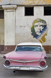 American car and Che Guevara in Cuba Stock Photos