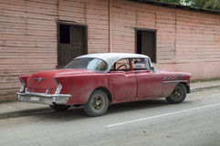 American car parked in Guantanamo suburbs, Cuba Royalty Free Stock Photography