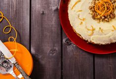 American carrot cake. On a dark wooden background Stock Images