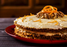 American carrot cake. On a dark wooden background Stock Photos