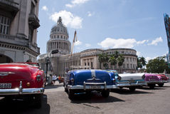American Cars face Cuban Capitol Stock Images