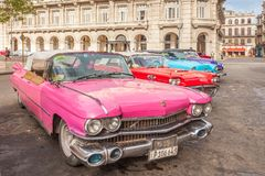 American cars in old Havana city center. Havana, Cuba-October 7, 2016. Old American cars from the 50s are parked near to Capitolio and waiting for tourists as royalty free stock photo