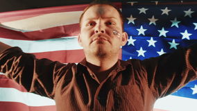 American caucasian male with American flag stock video footage