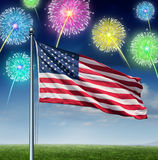 American Celebration. And national Holiday of  fourth of July concept as a USA flag flying over a sky with festive fireworks display as a symbol of United Stock Photo