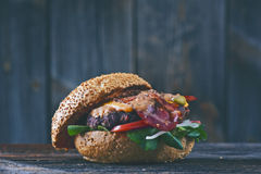 American cheeseburger with cheddar cheese with bacon and spicy s Royalty Free Stock Photo
