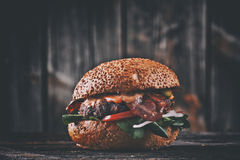 American cheeseburger with cheddar cheese with bacon and spicy s Stock Photos
