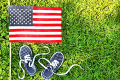 American children's sneakers and United States of America flag. Royalty Free Stock Photography