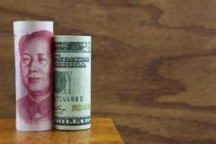 American and Chinese Currency against wood background Royalty Free Stock Photos