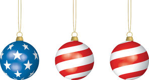 American Christmas. 3D illustration of three American Flag-themed Christmas Bulbs hanging from thin strings on white background Royalty Free Stock Photo