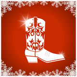 American christmas card with cowboy boot on red background Royalty Free Stock Photography