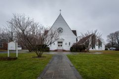 American church on cloudy weather. Old small white american church on cloudy weather Stock Photo