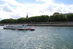 American Church in Paris, waterway, water transportation, river, boat. American Church in Paris is waterway, boat and motor ship. That marvel has water stock image