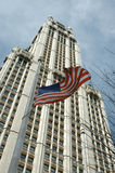 American city. Skyscrapper with USA flag on foreground stock photography