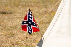 American Civil War confederate flag. Battlefield confederate flag on the side of a canvas tent suggesting a civil war confederate camp with lots of copypsace Royalty Free Stock Photo