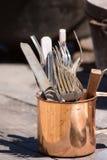 American civil war cutlery. Closeup of antique American civil war cutlery in copper colored cup Stock Images