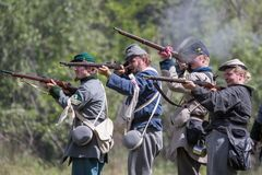 Rebels at War. American Civil War reenactors in action at the Dog Island event in Red Bluff, California Royalty Free Stock Photography