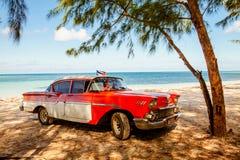 American classic car on the beach Cayo Jutias, Cuba stock photos